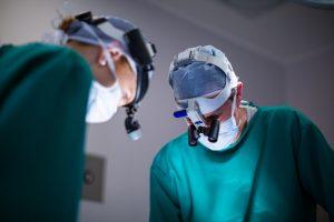 Surgeons wearing surgical loupes while performing operation in operation theater